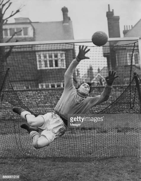 English footballer Edward Burgin of Sheffield United FC the goalkeeper of the England team during practice at The Saffrons ground in Eastbourne UK...