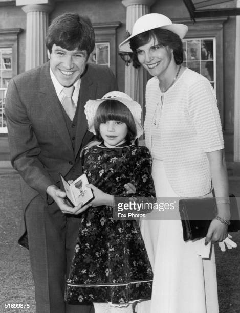 English footballer Emlyn Hughes OBE after his investiture at Buckingham Palace 4th March 1980 With him are his wife Barbara and daughter Emma aged six