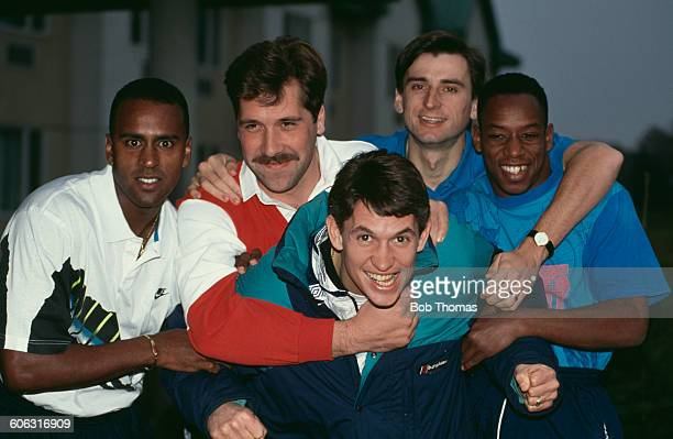 English footballer Gary Lineker of Tottenham Hotspur is held back by Arsenal players David Rocastle David Seaman Alan Smith and Ian Wright circa 1991