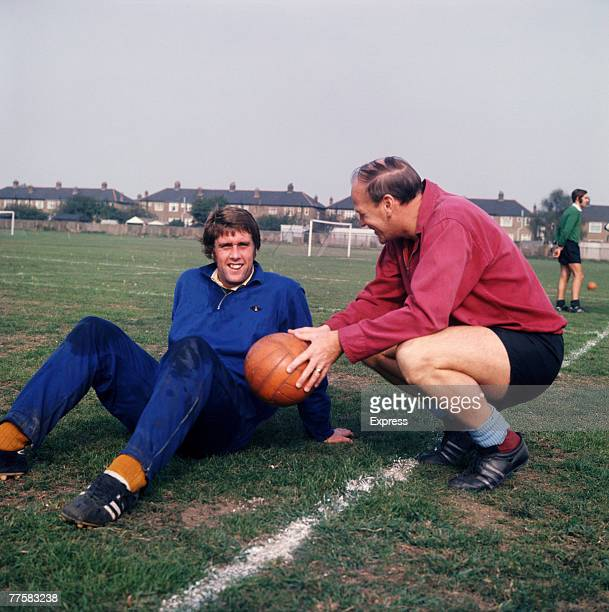 English footballer Geoff Hurst of West Ham United FC with the club's manager Ron Greenwood circa 1970