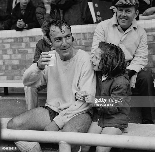 English footballer Jimmy Greaves of Tottenham Hotspur F.C. With his daughter Mitzi, 2nd August 1967.