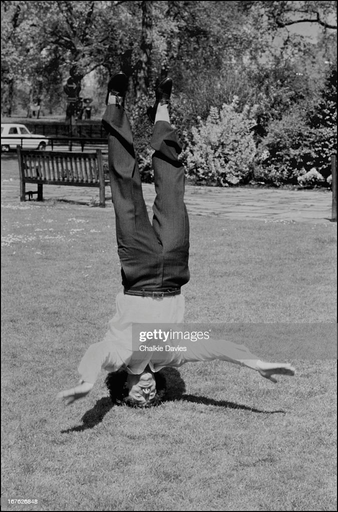 English footballer Kevin Keegan stands on his head, Park Lane, London, 1979.