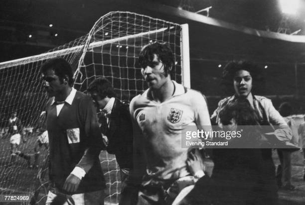 English footballer Malcolm Macdonald leaves the field after scoring all the goals in England's 50 victory over Cyprus in a European Championship...