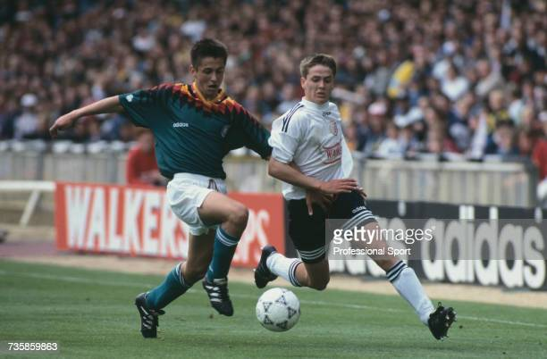 English footballer Michael Owen pictured on right trying to gain possession of the ball from a German player during an Under 15 game between England...