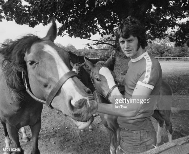 English footballer Mike Channon with some of the horses which he breeds at Lower Chase Farm, Hampshire, UK, July 1976.
