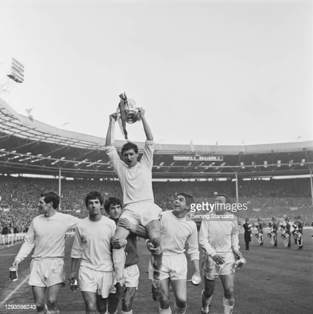 English footballer Mike Keen , captain of Queens Park Rangers FC, holds aloft the League Cup after the team won the Football League Cup Final against...