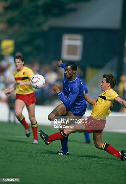 English footballer Paul Canoville of Chelsea FC and Wilf Rostron of Watford FC during a match UK circa 1985