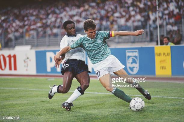 English footballer Paul Parker moves in to tackle West Germany captain Lothar Matthaus during the semi final match between West Germany and England...