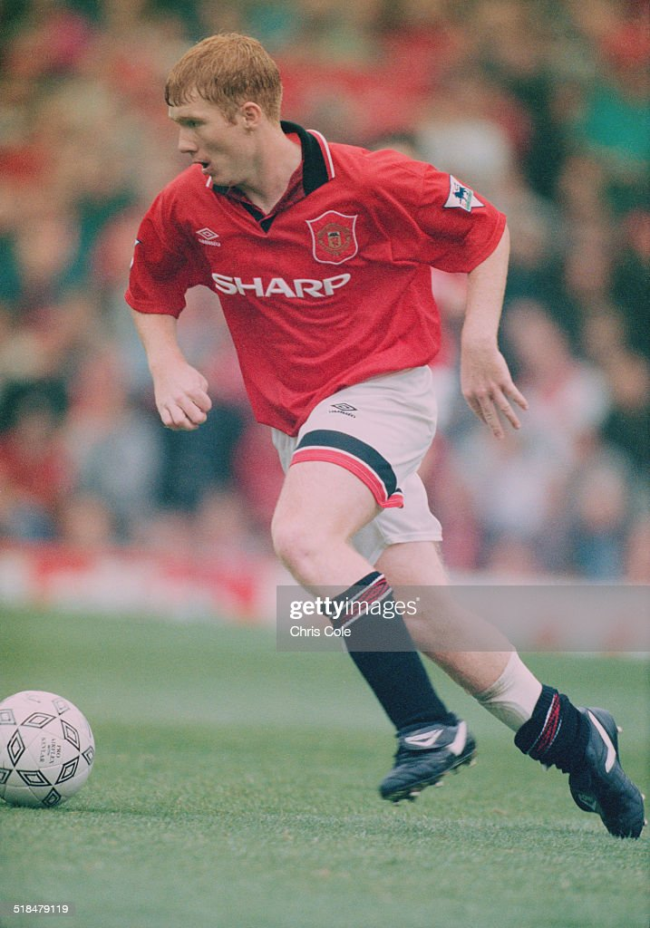 English footballer Paul Scholes playing for Manchester United against Wimbledon in an English Premier League match at Old Trafford, Manchester, 26th August 1995. United won the match 3-1.