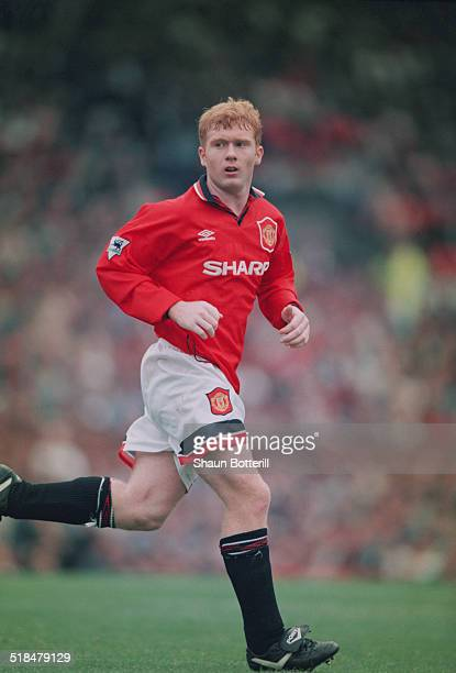 English footballer Paul Scholes playing for Manchester United against Bolton Wanderers in an English Premier League match at Old Trafford,...