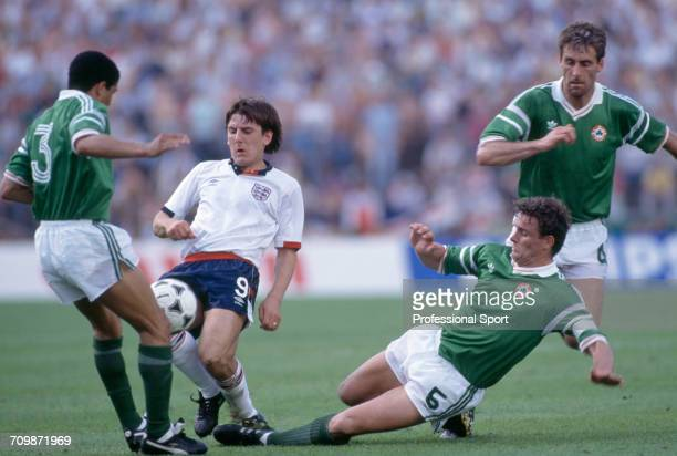 English footballer Peter Beardsley is tackled for the ball by Republic of Ireland players Chris Hughton and Kevin Moran as Mick McCarthy runs to...