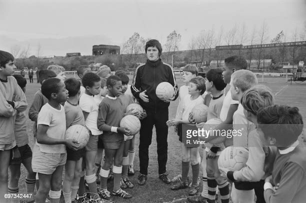 English footballer Peter Knowles of Wolverhampton Wanderers FC coaches forty schoolboys on Dunstall Park racecourse in the West Midlands UK 7th...