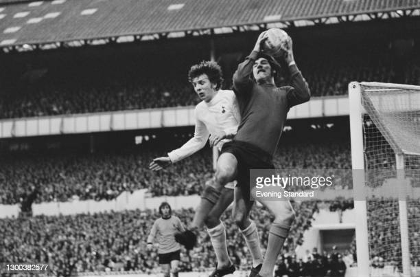 English footballer Phil Parkes , goalkeeper for Wolverhampton Wanderers, pictured with Martin Peters of Tottenham Hotspur during a UEFA Cup Final 2nd...
