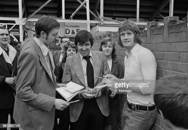 English footballer Rodney Marsh pictured on right signing autographs with Terry Venables as he re-visits his old club, Queens Park Rangers at Loftus...