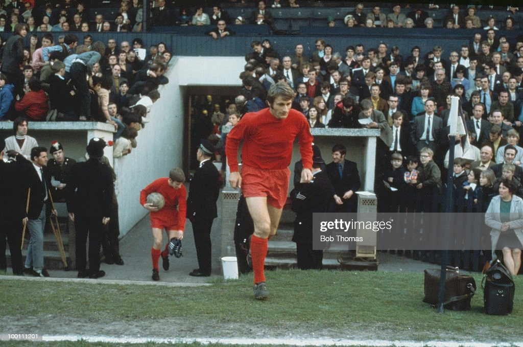 English footballer Roger Hunt of Liverpool runs onto the pitch at the start of a match, circa 1968.