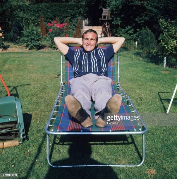 English footballer Ron 'Chopper' Harris of Chelsea FC relaxes on a lounger in his garden circa 1970