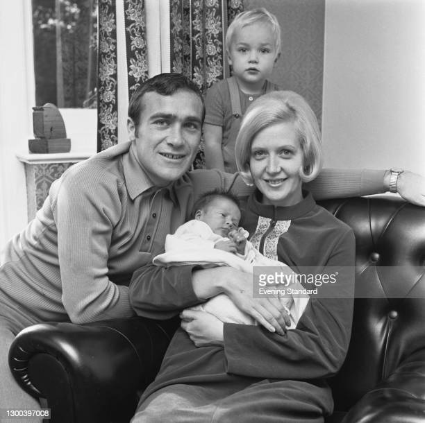 English footballer Ron 'Chopper' Harris of Chelsea FC with his wife Lee and their children Paul and new baby Mark, UK, 6th October 1972.