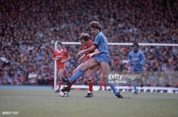 English footballer Sam Allardyce of Coventry City tackles Liverpool forward Kenny Dalglish during an English Division One match at Anfield Liverpool...