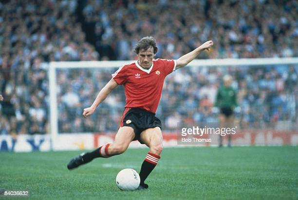 English footballer Steve Coppell in action for Manchester United in a first Division match against West Bromwich Albion at The Hawthorns 4th...