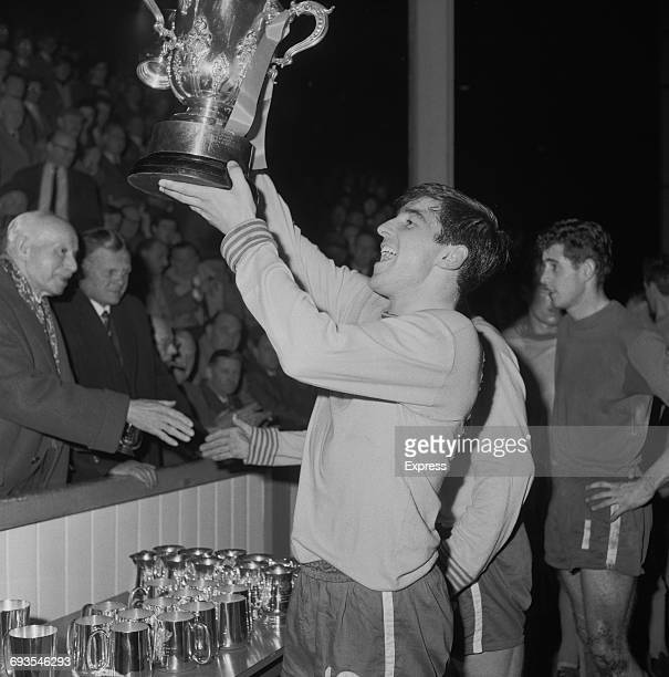 English footballer Terry Venables of Chelsea FC holds aloft the football League Cup after the second leg of the final between Leicester City and...