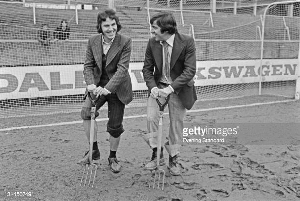English footballers Gerry Francis and Terry Venables of Queens Park Rangers digging on the pitch at Loftus Road in London, after the third round FA...