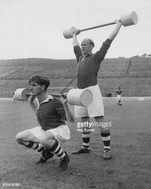 English footballers Gordon Hurst and Billy Kiernan of Charlton Athletic FC during training at The Valley London for the new football season 8th...