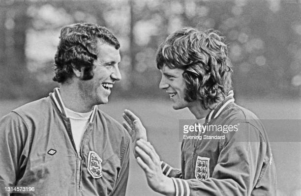 English footballers Peter Osgood and Mick Channon of the England squad, training at Stevenage, UK, 25th September 1973.