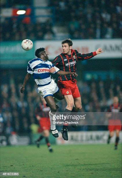 English footballers Rufus Brevett of Queens Park Rangers and Chris Sutton of Blackburn Rovers jumping for the ball during a Premier League match at...