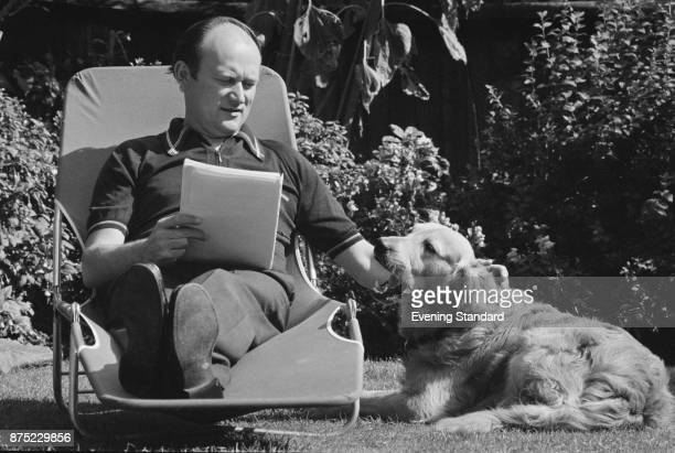English former football player George Petchey manager of Leyton Orient FC relaxes in a backyard with his dog London UK 16th September 1977