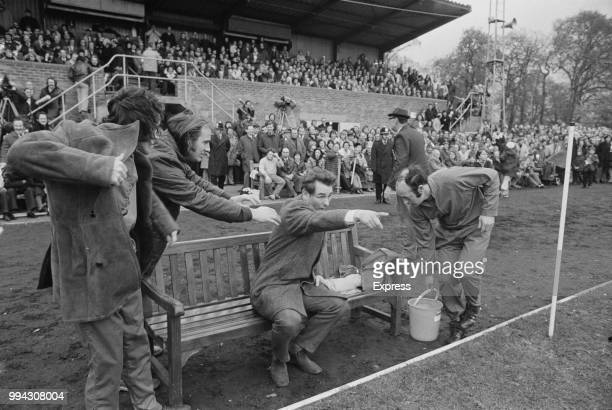 English former footballer and manager of Brighton & Hove Albion, Brian Clough points from a bench as he instructs his players during the FA Cup match...