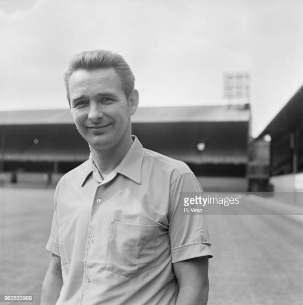 English former footballer and manager of Derby County Football Club, Brian Clough posed on the pitch at Derby County's Baseball Ground stadium in...