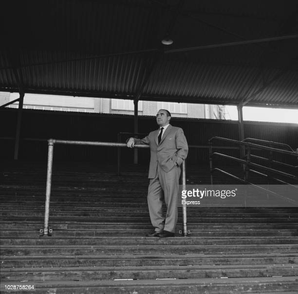 English former footballer and manager of Ipswich Town FC Alf Ramsey pictured standing on a terrace at Portman Road stadium in Ipswich for the final...