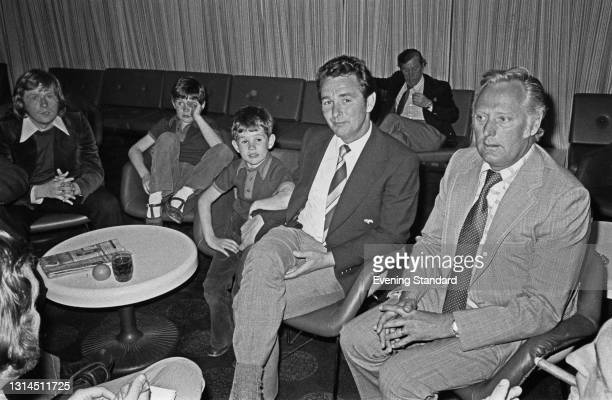 English former footballer Brian Clough , manager of Brighton and Hove Albion FC, with his sons Simon and Nigel and his assistant Peter Taylor , UK,...