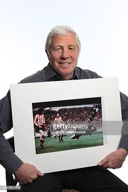 English former goalkeeper Jimmy Montgomery holding a photograph of his outstanding 1973 FA Cup Final double save from Trevor Cherry and Peter Lorimer...