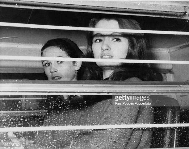 English former model and showgirl Christine Keeler and her friend Paula Hamilton-Marshall in a police van on their way from Marylebone Lane police...