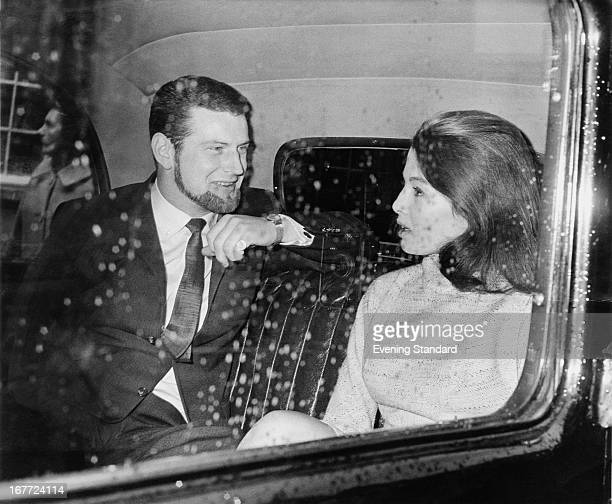 English former model and showgirl Christine Keeler with her friend journalist and racing driver Paul Mann on their way to Marylebone Court where...