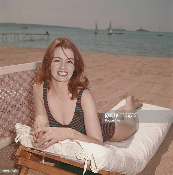 English former model showgirl and key figure in the Profumo scandal Christine Keeler posed wearing a swimsuit on a sun lounger on a beach in Cannes...