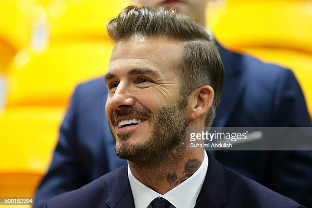 English former professional footballer David Beckham watches the Men's Team Football 5aSide match between Singapore and Thailand during the 8th ASEAN...