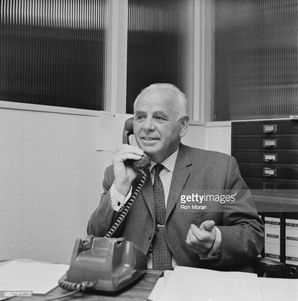 English former soccer player and manager of Bristol Rovers FC Bill Dodgin Sr speaking over the phone UK 12th September 1969