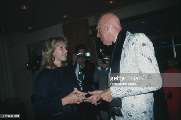 English former tennis player and tennis fashion designer Ted Tinling pictured meeting German tennis player Steffi Graf at an event in Paris France...