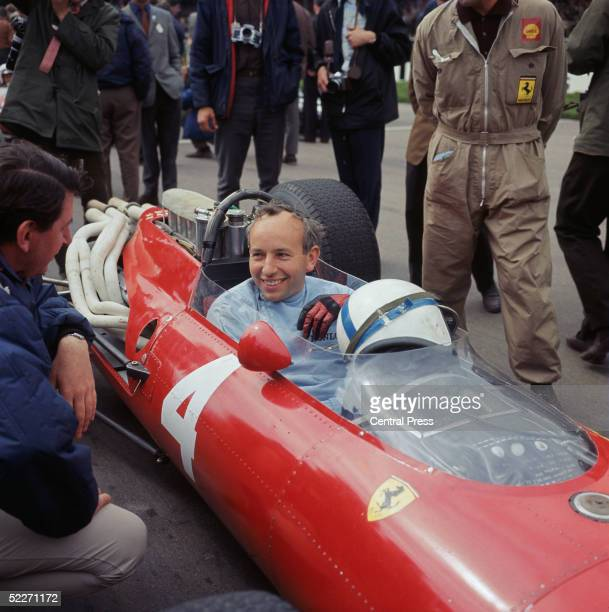 English Formula 1 racing driver John Surtees in a Ferrari at the Silverstone circuit 1966