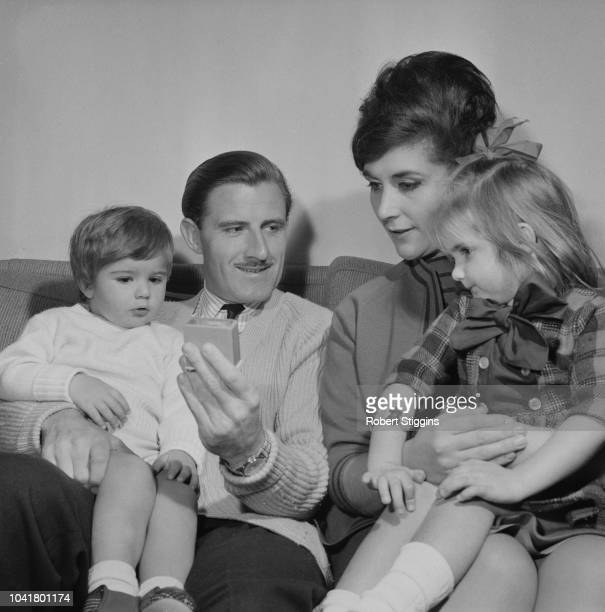 English Formula One World Champion racing driver Graham Hill pictured with his wife Bette, daughter Brigitte and son Damon at home on 10th January...