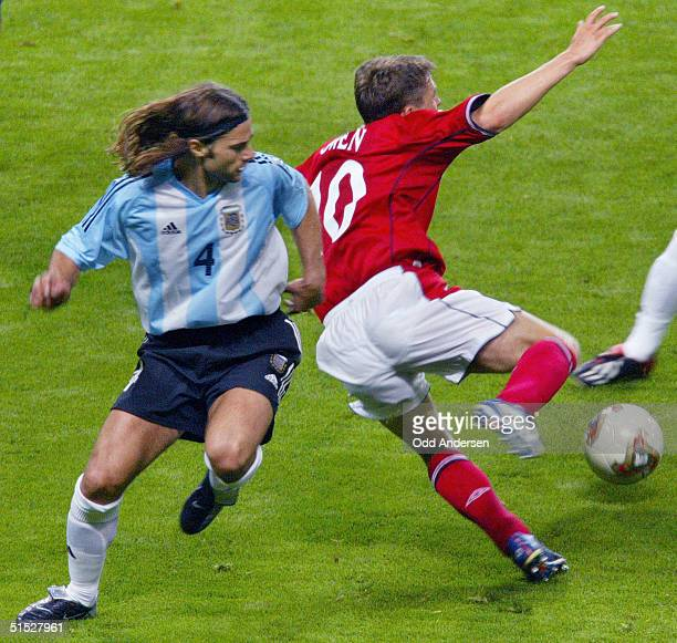 English forward Michael Owen is tackled by Argentinian defender Mauricio Pochettino during the Group F first round match Argentina/England of the...