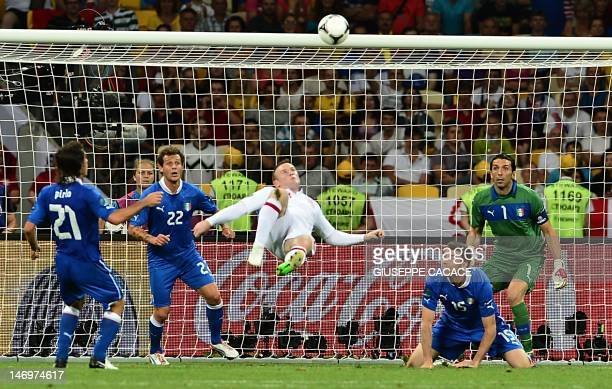 English forward Wayne Rooney makes a bicycle kick during the Euro 2012 football championships quarter-final match England vs Italy on June 24, 2012...