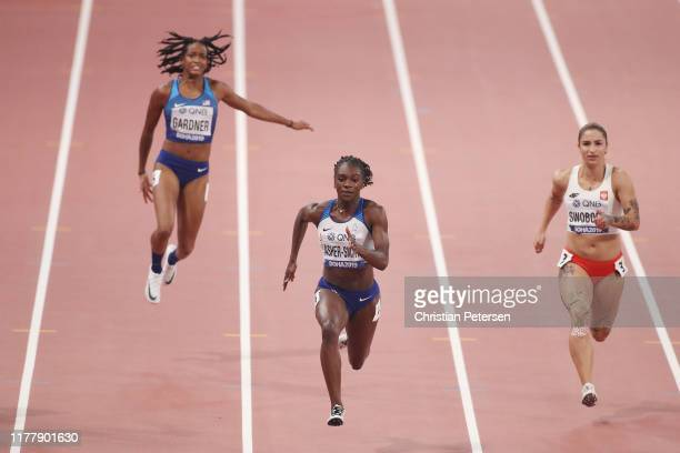 English Gardner of the United States reacts to an injury as Dina AsherSmith of Great Britain and Ewa Swoboda of Poland compete during the Women's 100...