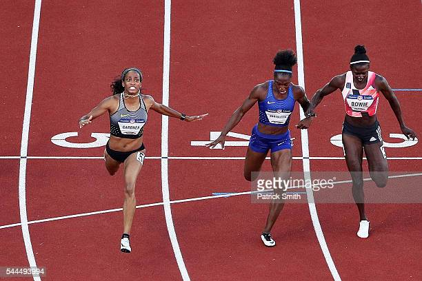 English Gardner Tianna Bartoletta and Tori Bowie cross the finish line in the Women's 100 Meter Final during the 2016 US Olympic Track Field Team...