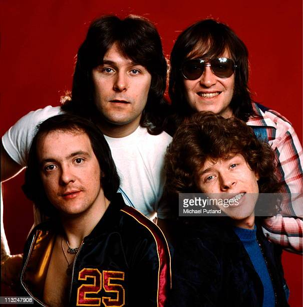English glam rock band Mud studio group portrait London clockwise from bottom left Dave Mount Ray Stiles Les Gray Rob Davis