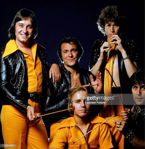 English glam rock band Mud studio group portrait London September 1975 clockwise from top left Les Gray Dave Mount Rob Davis Ray Stiles unknown