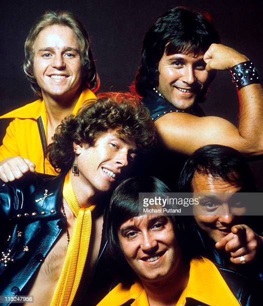 English glam rock band Mud studio group portrait London September 1975 clockwise from top left unknown Ray Stiles Dave Mount Les Gray Rob Davis