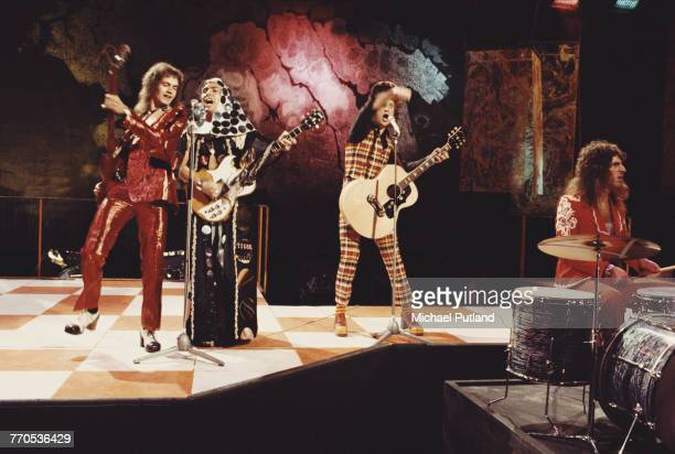English glam rock group Slade perform on the BBC TV show Top of the Pops in London in 1973 The group are from left to right bassist Jim Lea guitarist...